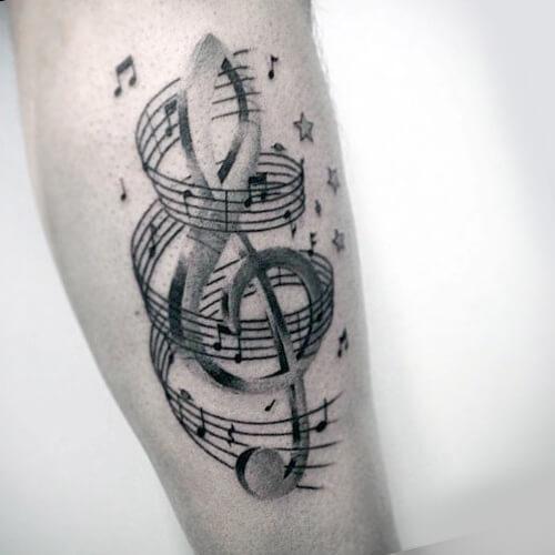 Tatuajes clave de sol y pentagrama